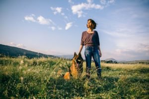 Woman with German Shephard outdoor