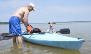 Man with dog on a Kayak