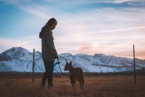 Woman staring at her dog with leash