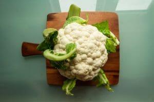 A cauliflower on a chopping board