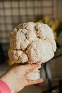 holding a big cauliflower