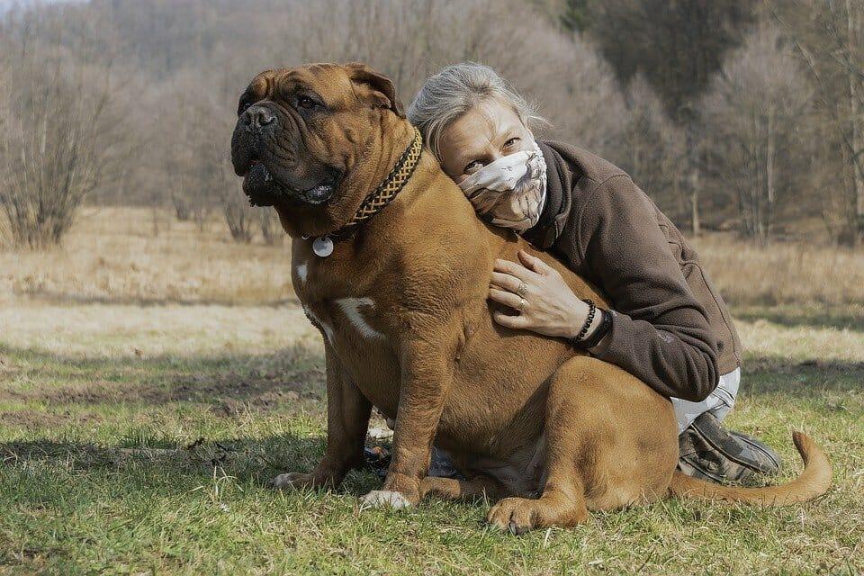 Pet owner hugging her dog